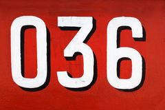 Numéro 036 sur le fond rouge Photos libres de droits