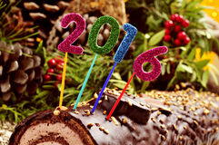 Numéro 2016 sur un gâteau de rondin de Noël Photographie stock libre de droits