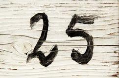 Numéro vingt-cinq en bois photographie stock