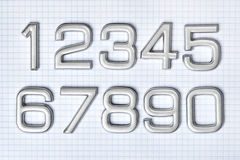 Numéros argentés photographie stock