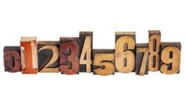 Numéros dans le type en bois Photographie stock libre de droits