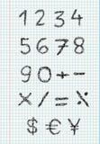 Numéros de griffonnage sur le papier carré Photos stock