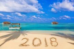 Numéros 2018 sur la plage Photographie stock libre de droits