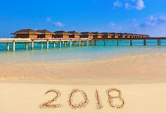 Numéros 2018 sur la plage Image stock