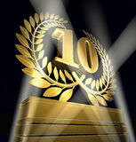Number 10. Golden laurel wreath with number ten inside on a golden pedestal Stock Photo