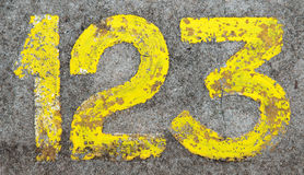 Number 123 painted on concrete ground. The numbers 123 painted in yellow on concrete ground Royalty Free Stock Photography