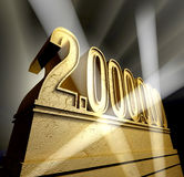 Number 2.000.000. Number two million in golden letters on a golden pedestal Stock Photos