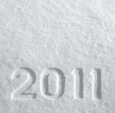 Number 2011 on glittering snow. Number 2011 written on glittering snow, New Year's background stock photos