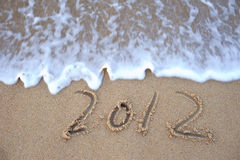 Number 2012 on the beach sands Royalty Free Stock Photos