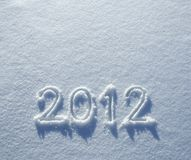 Number 2012 on snow. Number 2012 written on glittering snow, New Year's background Royalty Free Stock Photo