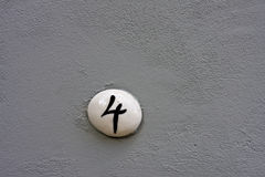 Number 4 on a wall royalty free stock photos
