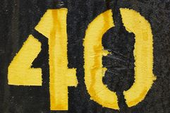 The number 40. Spray painted on a black background Royalty Free Stock Image