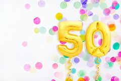 Free Number 50 Fifty Made Of Golden Inflatable Balloons With Golden Ribbons On Colorful Confetti Background Stock Photos - 189780263