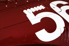 Number 56 of red car. White number 56 of red old sport car Royalty Free Stock Images