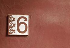 A number 6 tile with Maya symbol on red background Stock Images