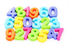 Number. Colorful plastic number on white background - math time Stock Images