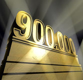 Number 900.000. Number nine hundred thousand in golden letters on a golden pedestal Royalty Free Stock Photography