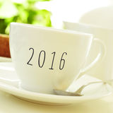 Number 2016, as the new year, on a cup of coffee or tea Stock Photos