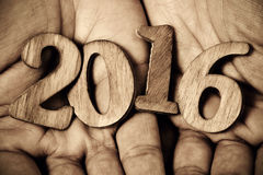 Number 2016, as the new year, in the hands of a man Stock Photo