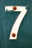 Number 7 attached with rusty nails Royalty Free Stock Image