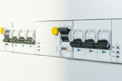 A number of automatic switches and differential circuit breakers. With led indication of the module implementation. Covered with protective panels in the Royalty Free Stock Photos