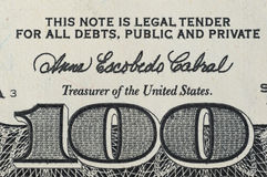 Number 100 on the banknote hundred dollars royalty free stock photo