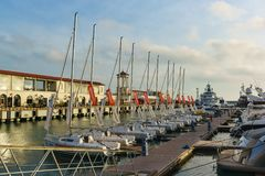 A number of beautiful white yachts at the pier in the seaport of Sochi. Summer evening Stock Photos