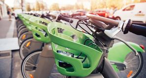 Number of bicycles are on parking for rent by tourists contactless payment royalty free stock photo