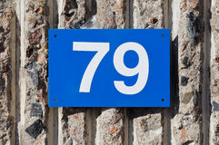 Number 79 on blue blate Royalty Free Stock Image