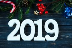 2019, branches of fir tree, decor on grey wooden table. New Year Goals list, things to do on Christmas. 2019 number branches of fir tree, decor on grey wooden royalty free stock photography