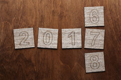 Number 2017. Bricks with numbers on wooden background stock illustration