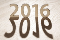 Number 2016. On brown wooden background (new year 2015-2016 Stock Photos