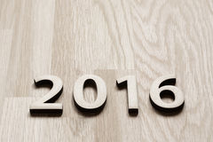 Number 2016. On brown wooden background (new year 2015-2016 Royalty Free Stock Photo