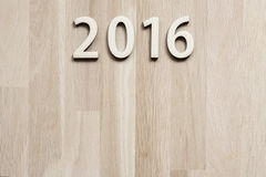 Number 2016. On brown wooden background (new year 2015-2016 Royalty Free Stock Image