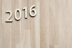 Number 2016. On brown wooden background (new year 2015-2016 Stock Photo