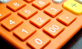 Number button on orange calculator Royalty Free Stock Photography