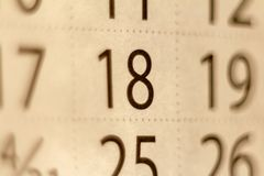 18 number on the calendar sheet. stock photo