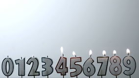 Number candles blowing out in numerical order with copy space Royalty Free Stock Images