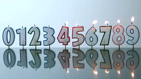 Number candles blowing out in numerical order Stock Photo
