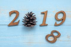 2019 number with Christmas decorations on wooden background, Business Goals, Mission, Resolution, New Year New You royalty free stock image
