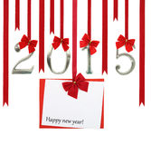 2015 number and Christmas. Greeting card hanging on red ribbons Royalty Free Stock Photography