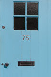 Number 75 close up on a blue door Royalty Free Stock Photography