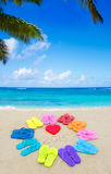 Number 2015 with color flip flops on the beach Royalty Free Stock Photos