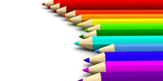 A number of colored pencils lying around with focus effect Stock Photo