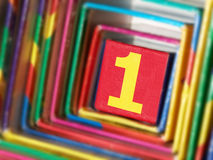 The number 1 in a colorful surround Stock Images