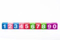 Number. On colorful wooden block and isolate from hite background Stock Photos