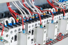 The number of contactors arranged in a row in an electrical closet. The contactors connected wire number coded. Contactors with front auxiliary contacts. The Royalty Free Stock Photo