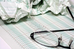 Number Crunching. This is an image of ledger paper with numbers and a pair of glasses royalty free stock photo