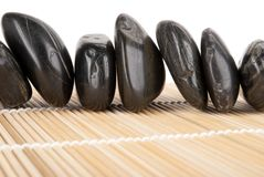 Number of dark stones lies on mat Stock Photo