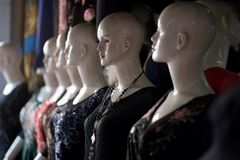 A number of dummies for samples of clothes. In the shop of the merchant royalty free stock image